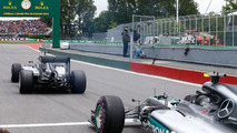 Nico Rosberg, Mercedes AMG F1 W07 Hybrid and Lewis Hamilton on the grid