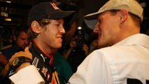 Sebastian Vettel (GER), Red Bull Racing is congratualted by Michael Schumacher (GER), Mercedes GP Petronas - Formula 1 World Championship, Rd 19, Abu Dhabi Grand Prix, 14.11.2010