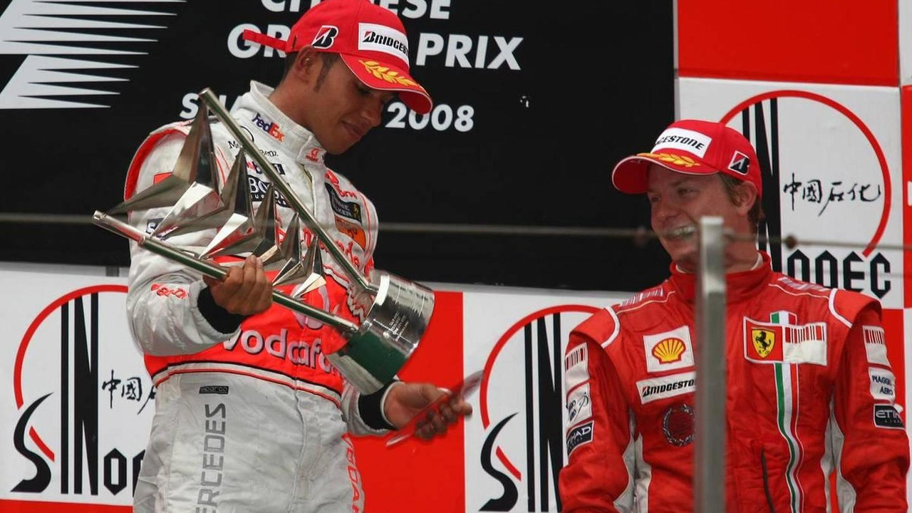1st place Lewis Hamilton (GBR), McLaren Mercedes with the trophy which fell apart, Kimi Raikkonen laughs, Chinese Grand Prix, 19.10.2008 Shanghai, China