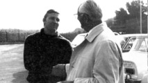 Tom Meade (left) shakes hands with Enzo Ferrari (right)