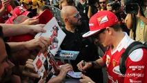 Kimi Raikkonen, Ferrari signs autographs for the fans