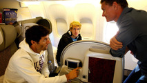 Sebastian Vettel and team mate Mark Webber chat with former F1 driver and BBC commentator David Coulthard on their flight to Red Bull headquaters in Austria from Abu Dhabi on November 15, 2010