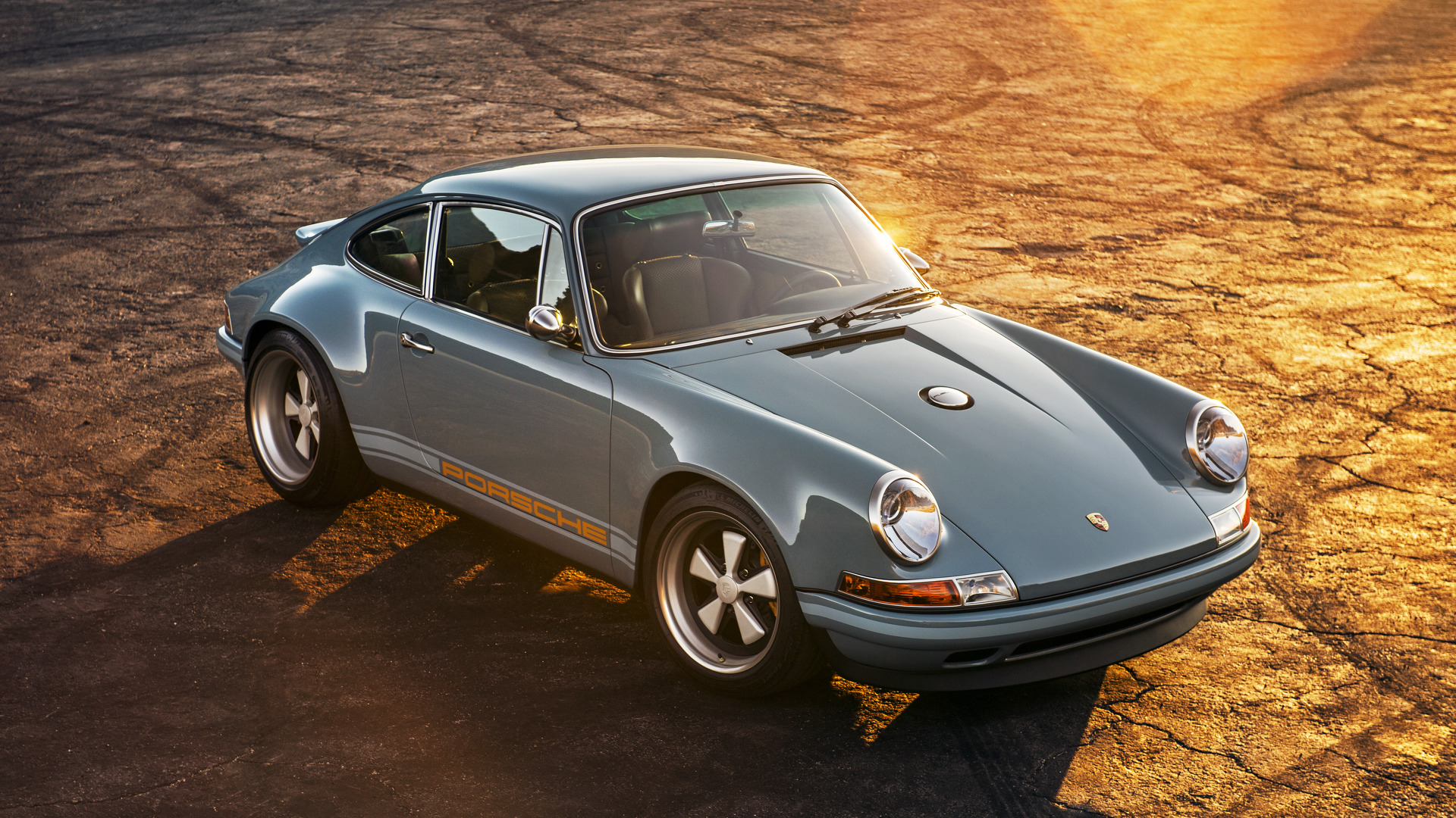 2 of singer s restored porsche 911s add style to amelia island