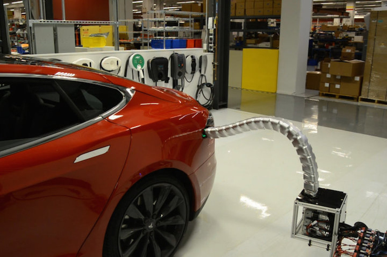 Tesla's Automatic Charger Prototype is Kind of Creepy, Mostly Amazing