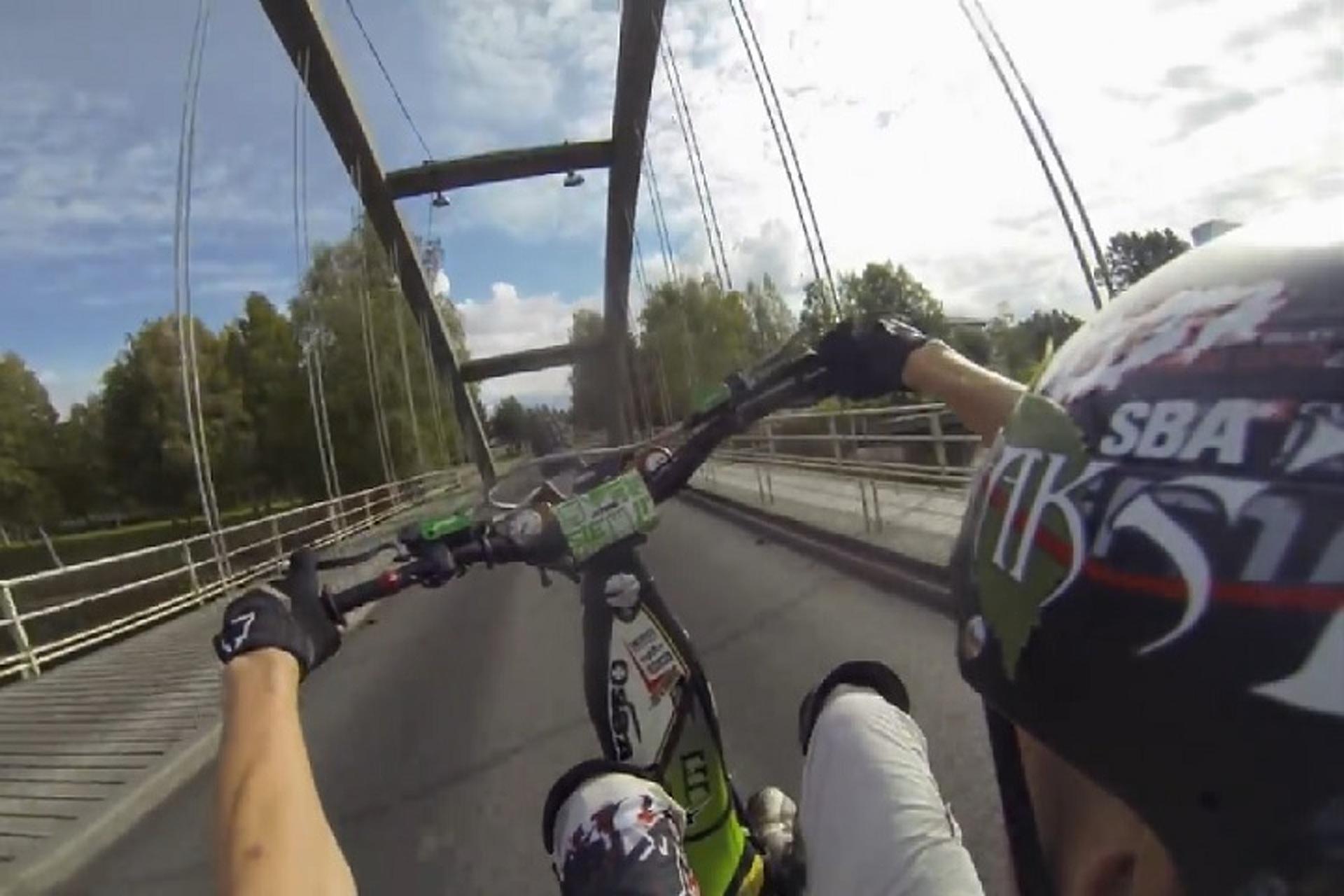 Watch This Insane Cyclist Ride Across a Bridge Arch