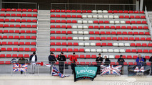 Lewis Hamilton, Mercedes AMG F1 fans, flags, and banners