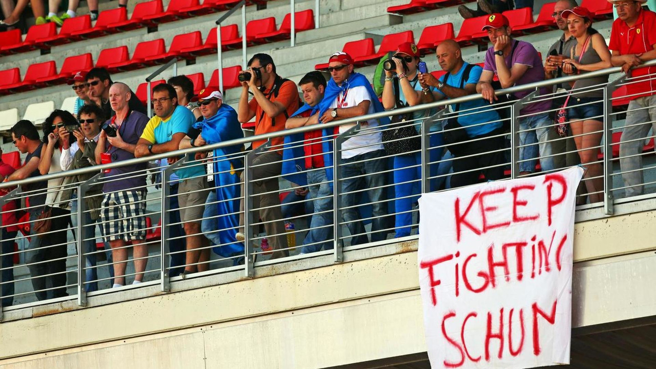 A banner of support for Michael Schumacher (GER) in the grandstands / XPB