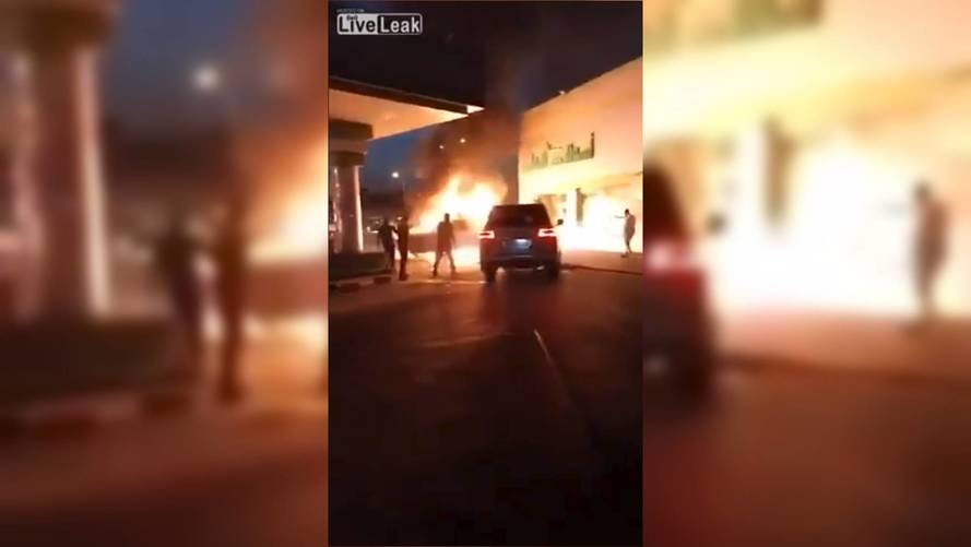 Watch This Land Cruiser Shove A Burning Car From Gas Station