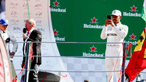 Race winner Lewis Hamilton, Mercedes AMG F1, takes a photo from the podium