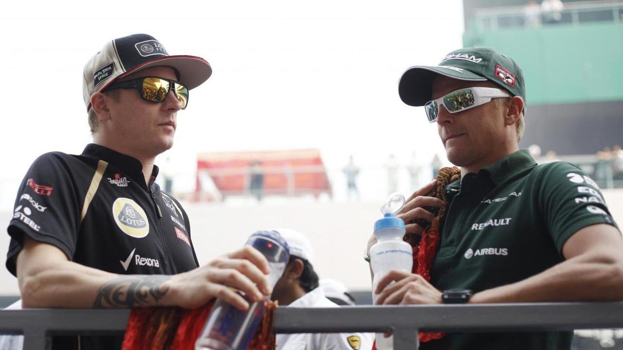 Kimi Raikkonen with Heikki Kovalainen 28.10.2012 Indian Grand Prix