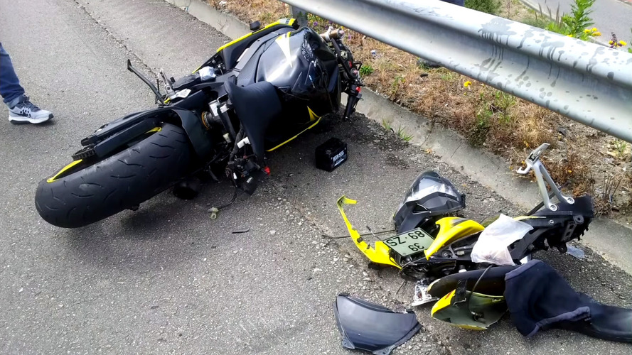 Lucky Rider Lands On Car After Crash