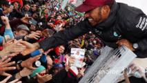 Lewis Hamilton celebrates with the team